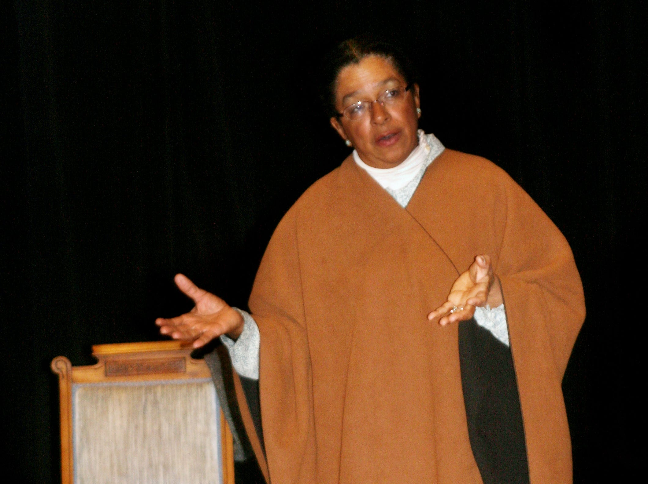 2011: Storyteller Vicie Rolling portrays Lear Green, a young slave who escaped to freedom on a ship in a steamer trunk, during a performance Monday at 171 Cedar Arts Center in Corning.