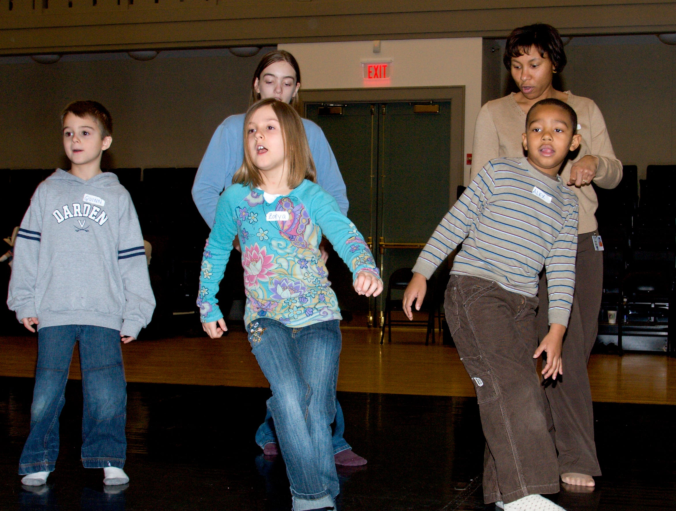 2007: Youngsters, from left, Quinn Nicholson, 7, of Painted Post, Zorya Webster, 7, of Corning, and Alex Derry, 6, of Horseheads, practice  dance routines with help from volunteers Gabriella Caruso, 11, of Corning, and Robin Walton of Painted Post during Martin Luther King Jr. Day  activies at 171 Cedar Arts Center Monday afternoon.
