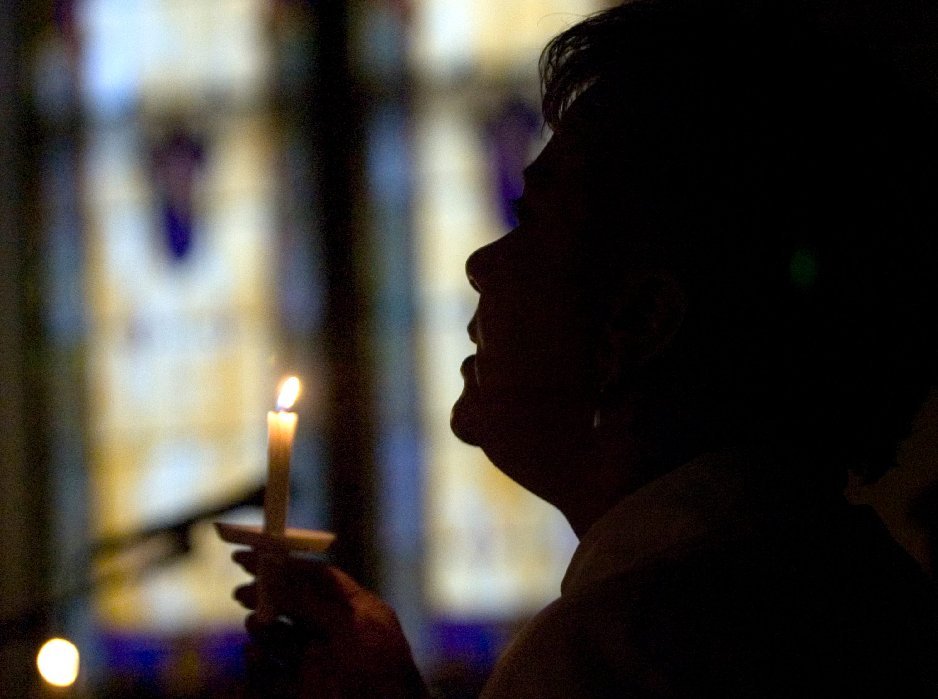 2007: Brenda Cave-James sings by candlelight during a Martin Luther King, Jr. celebration Sunday at Central United Methodist Church in Endicott.