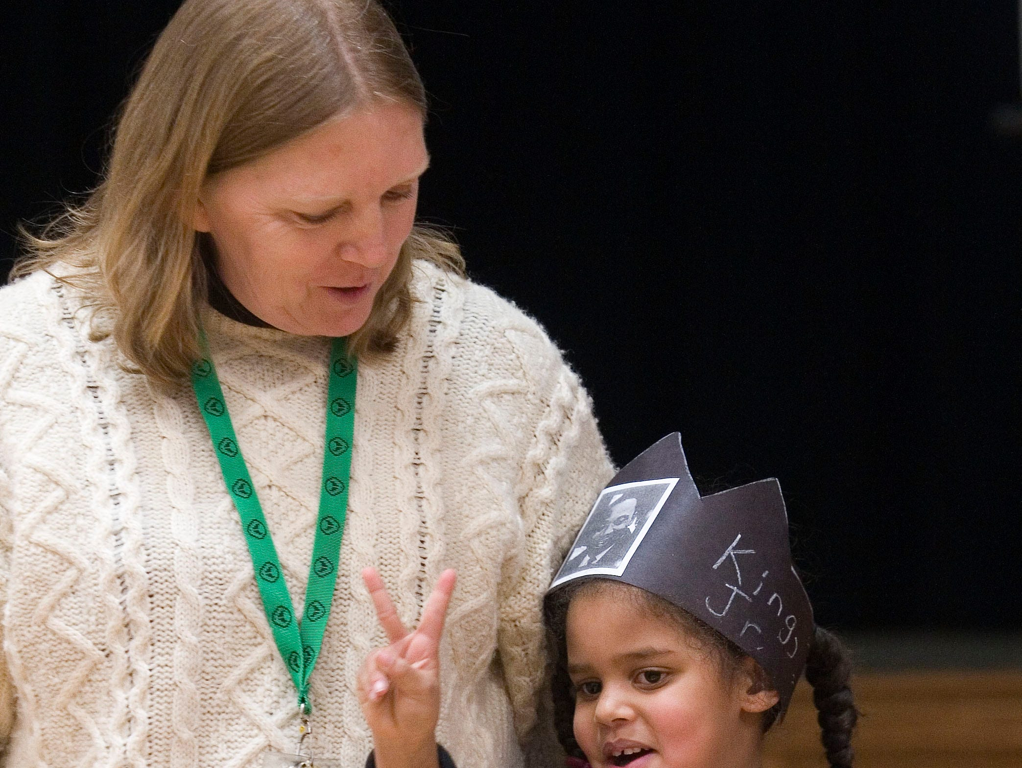 2010: Fassett Elementary School teacher Christina Cecce and kindergartner Ciara Sanchez  sing 'Talk About Peace' as they honor the memory of Martin Luther King Jr. Friday afternoon.