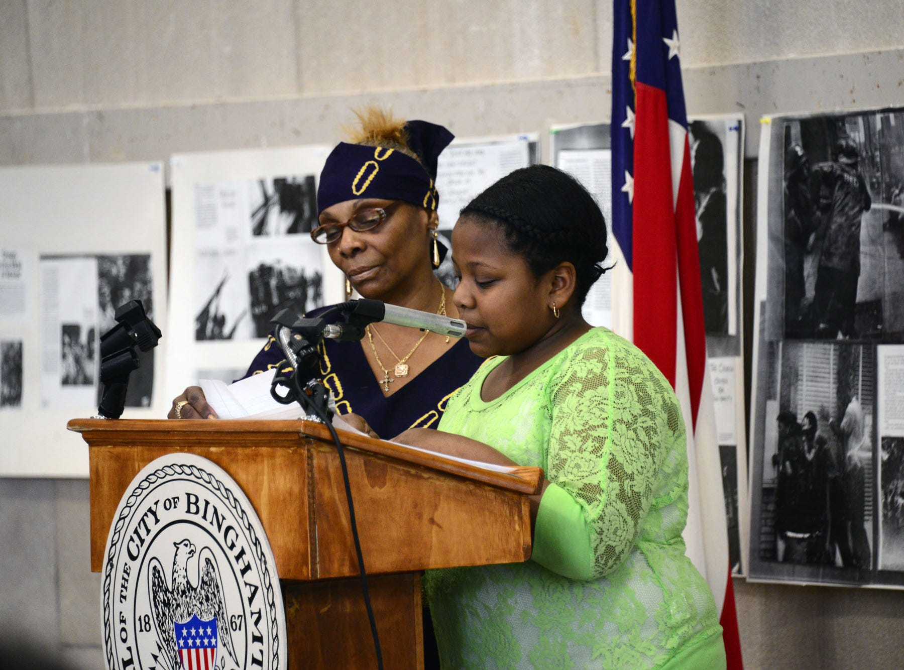 """2013: Tania Cureton, a 7th grader from Jenny F. Snap middle school reads her essay """"Through the eyes of a child"""" during a Martin Luther King ceremony hosted by the NAACP at Binghamton's City Hall on Monday, Jan. 21, 2013."""