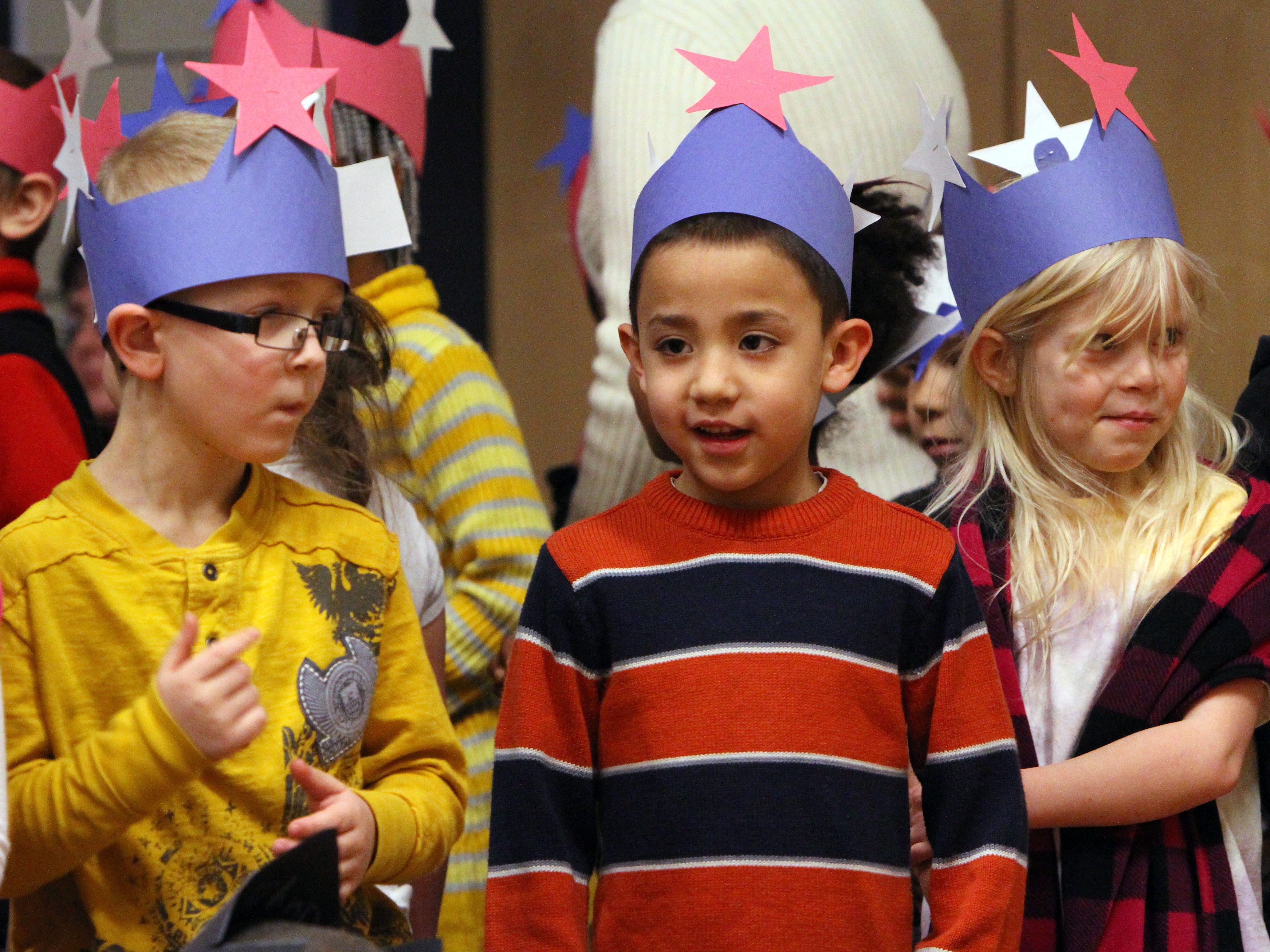 """2012: Fassett Elementary School first-graders, from left, Colin Sherman, Giuseppe Bustamante and Adria Stephenson sing """"America the Beautiful"""" during the Martin Luther King, Jr. assembly Friday afternoon."""
