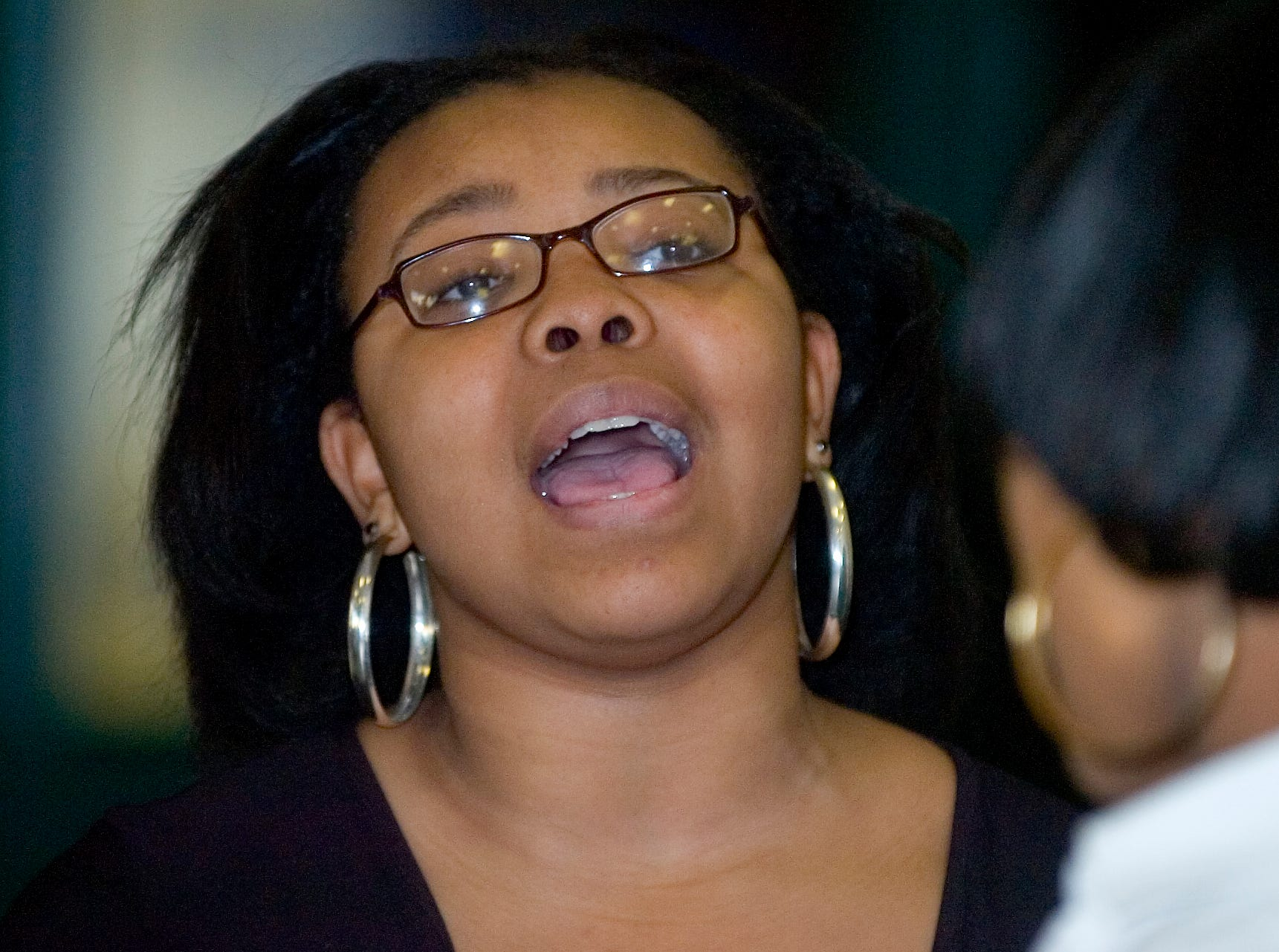 2008: Alexis Spight with the Greater Faith & Deliverance Ministries Praise Team sings during the Martin Luther King, Jr. Day Celebration held at  Binghamton City Hall on Monday.The event was sponsor by the Broome / Tioga Branch of the National Association for the Advancement of Color People