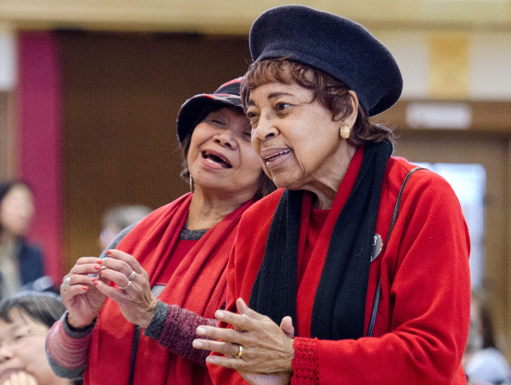 2014: Dr. Dorothy Cotton, right, and Mimi Melegrito, dance and clap to the music of the Baptized Church of Jesus Christ at the annual Martin Luther King Jr. Community Breakfast and Awards Ceremony.