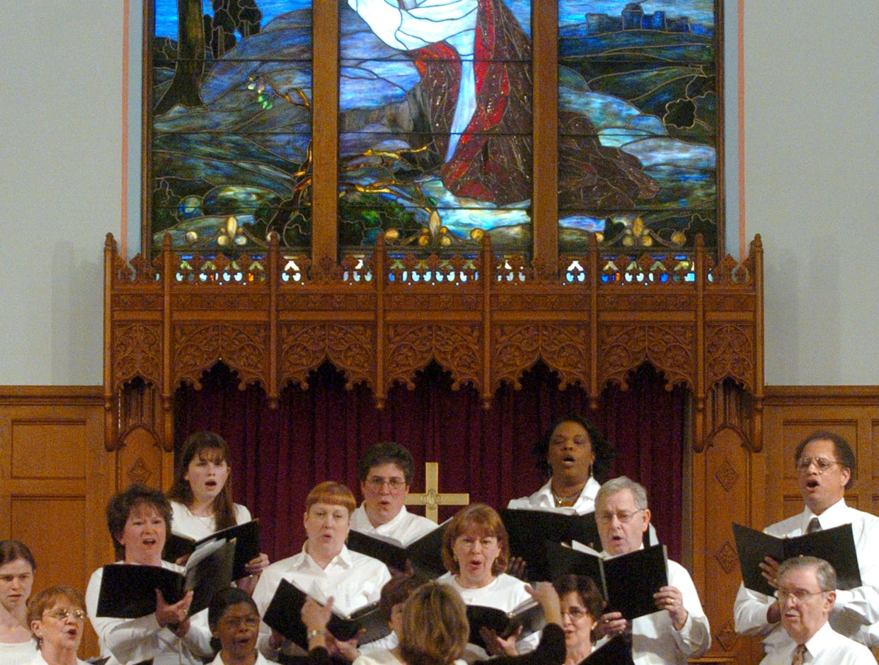 2006: The combined choirs of Central United Methodist Church and Trinity AME Zion Church sing during a church service in celebration of Dr. Martin Luther King Jr., at Central United Methodist Church Sunday in Endicott.