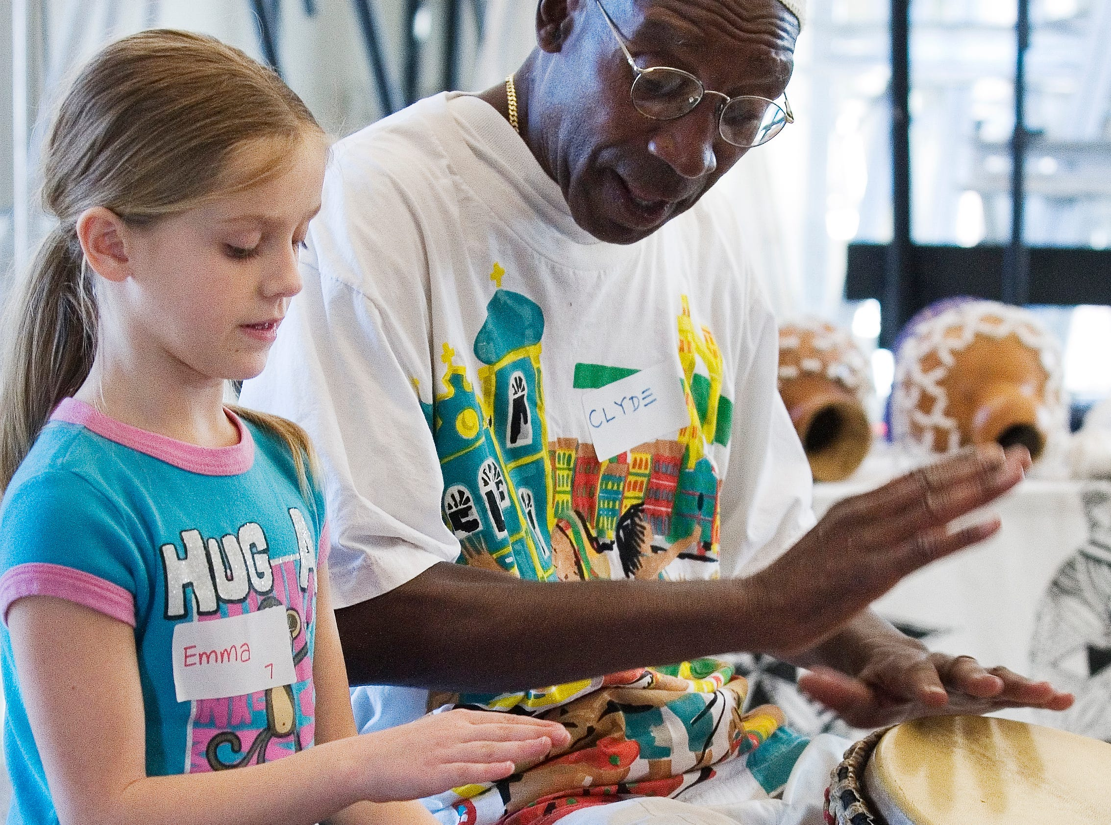 2009: Emma Brown, 7, plays the drum with encouragement form Clyde Morgan, associated professor of dance at SUNY Brockport,  during 24th Annual Making Real the Dream celebration at 171 Cedar Arts Center in Corning Monday.