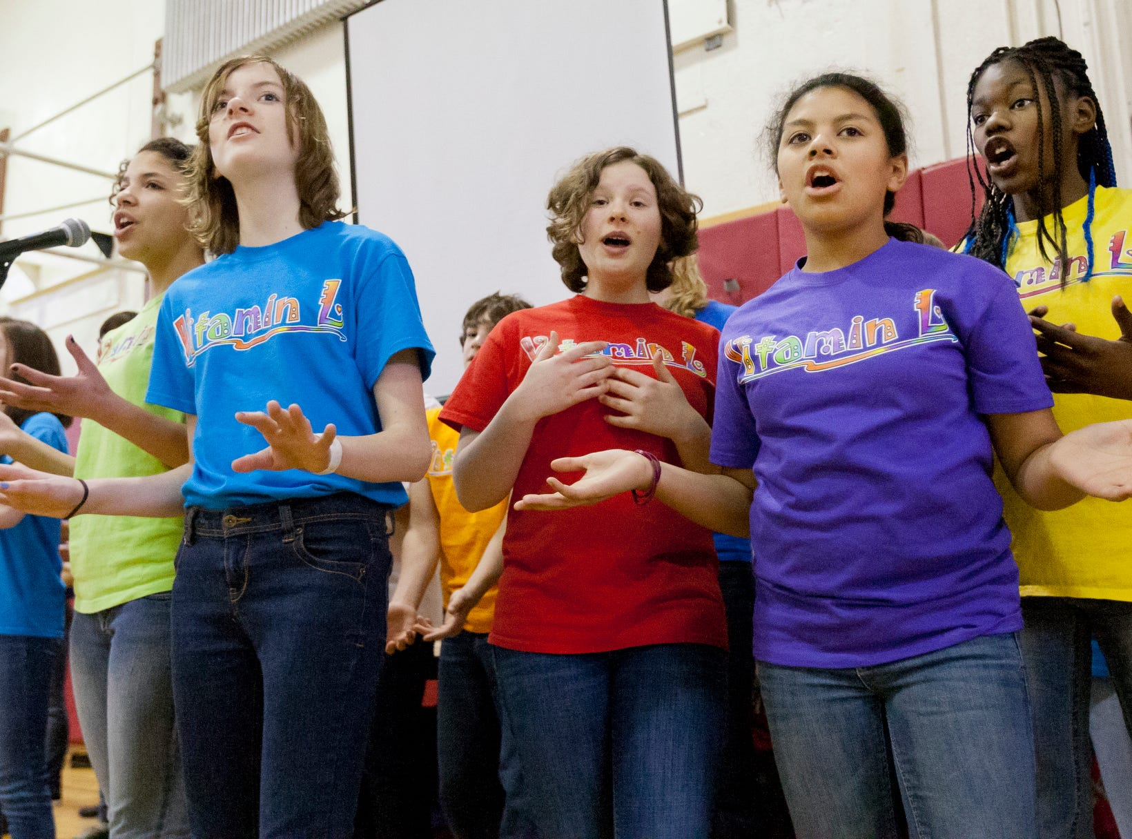 2013: The Vitamin L chorus sings new songs about Martin Luther King Jr.  during their three-song performance Monday in the gym at Beverly J. Martin school during the annual free community luncheon and celebration of the life of Dr. Martin Luther King, Jr.