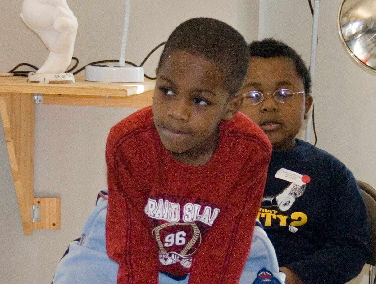 2008: Lamar Williams, center, 5, of Horseheads, listens to a story Monday morning during Making Real the Dream Youth Program at 171 Cedar Arts Center in Corning.