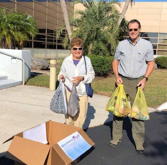 Janice Karnavas of Indian Harbour Beach and Dennis Huff of Merritt Island drop off donations for Operation Gratitude Tuesday at FLORIDA TODAY. The drive, assisting deployed troops and first responders, continues Wednesday in the parking lot in front of the newspaper's U.S. 1 office.