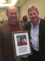 Merrill Worden (left) poses with his FACA Hall of Fame plaque and fellow longtime coach Dale Mays.