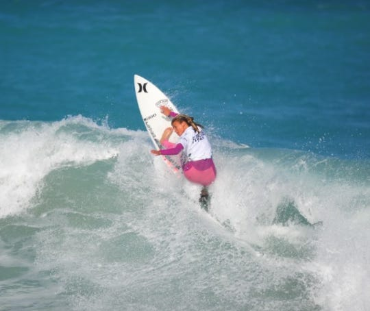 Zoe Benedetto, 13, of Palm City pulled off perhaps the day's biggest stunner, winning her heat against Pauline Ado, a former WCT pro.