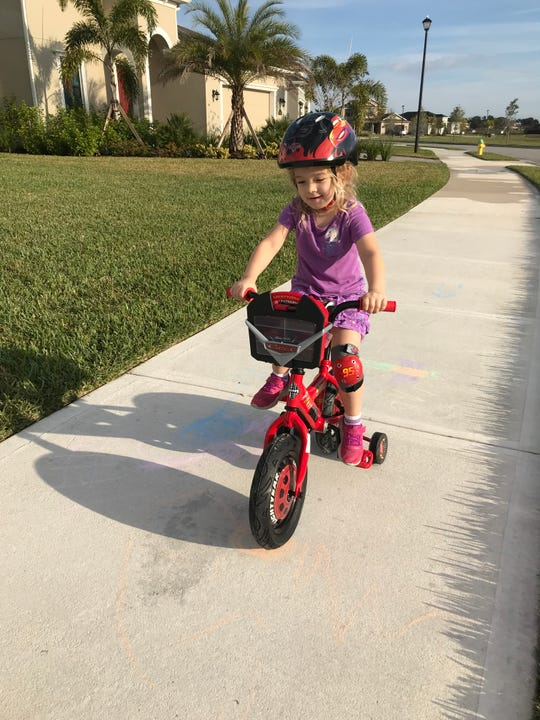Isabella takes a stroll on her bike on a recent sunny day. Before we know it, the training wheels will come off.