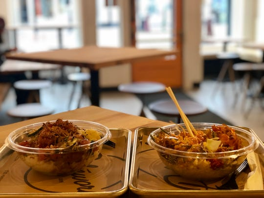 Pokeworks dishes rest on a table at the newly-opened restaurant on Church Street, Jan. 15, 2019.