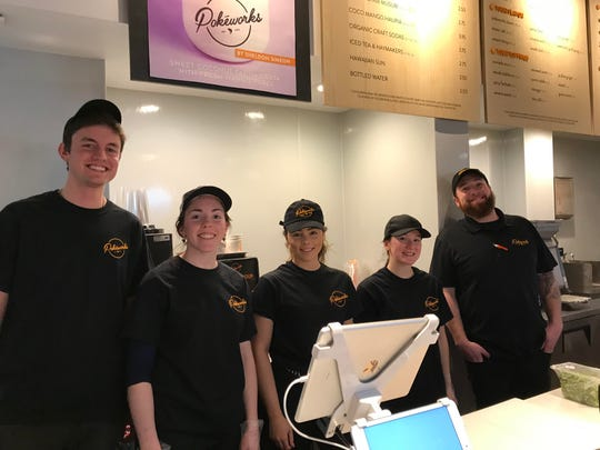 Pokeworks staff poses for picture less than a week after opening on Church Street, Jan. 15, 2019.