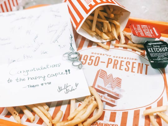 Arianne and Jordan Moore had a wedding ceremony inside a Whataburger restaurant in January 2019. Store employees signed a card to congratulate the couple.