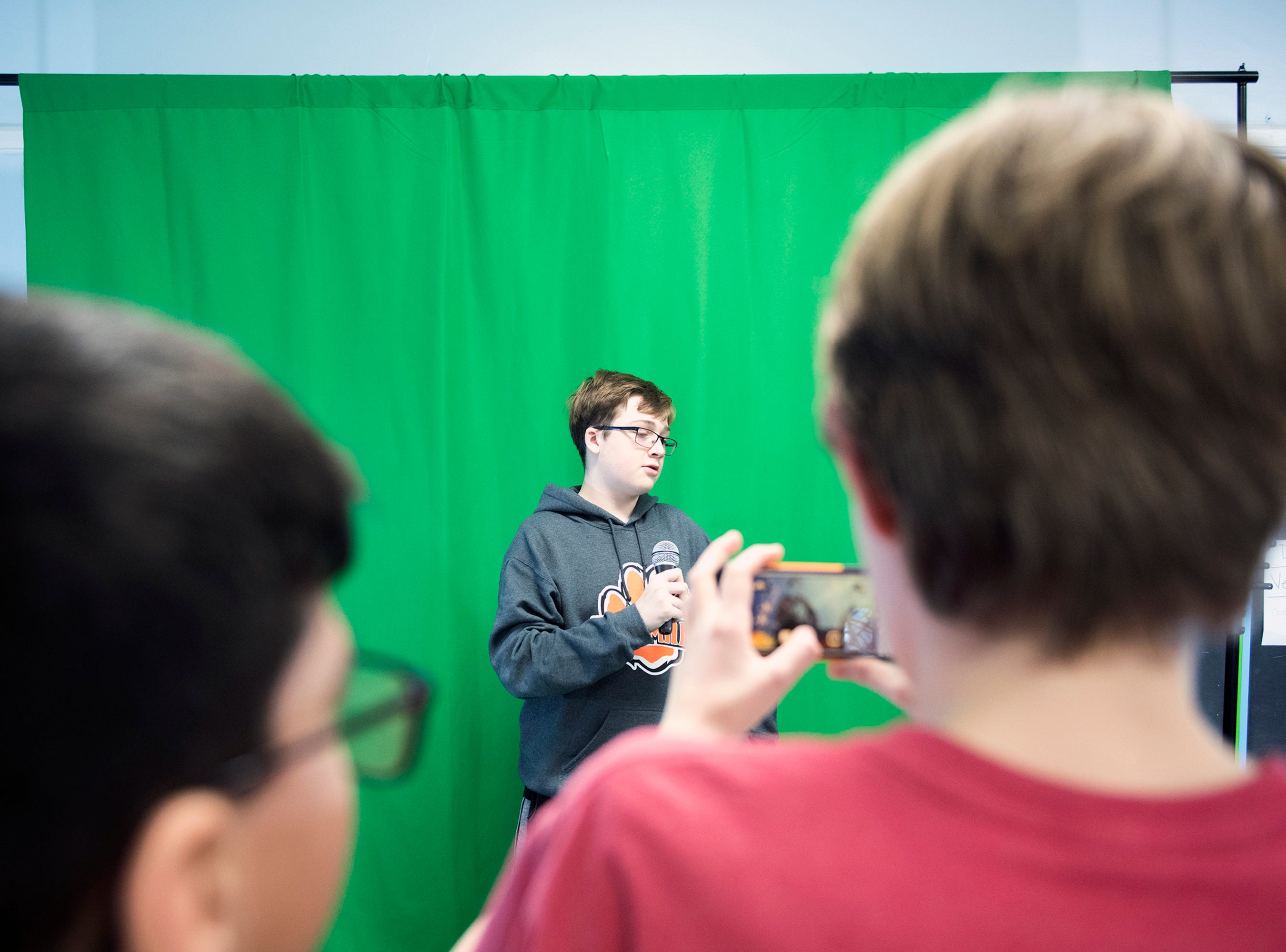 Matt Pauman, 12, stands in front of a green screen at Pitman Middle School's MakerSpace Thursday, Jan. 10, 2019 in Pitman, N.J.