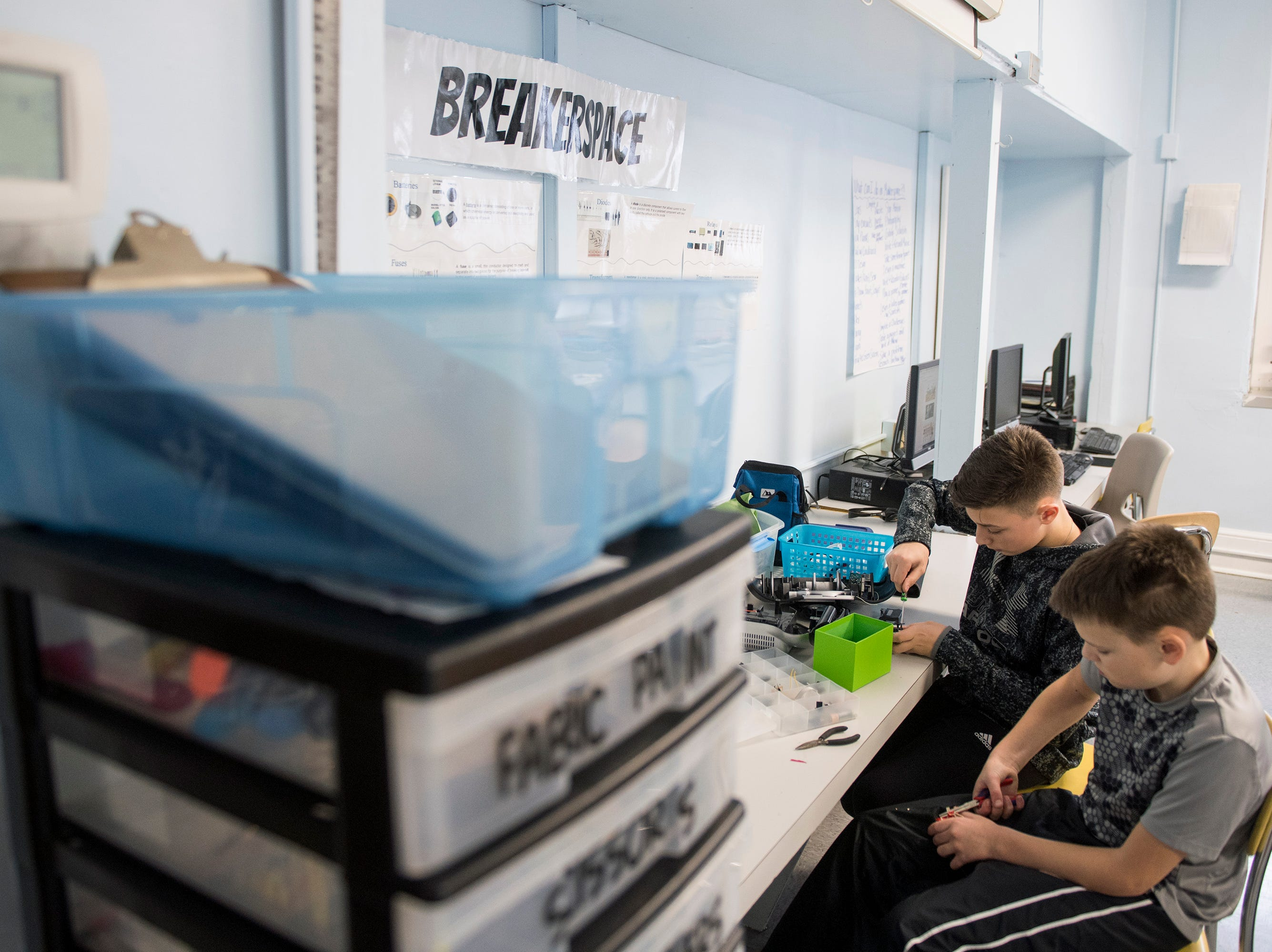Gino Riccardi, 12, left, and Andrew McIntyre, 13, take apart radios at Pitman Middle School's MakerSpace Thursday, Jan. 10, 2019 in Pitman, N.J.