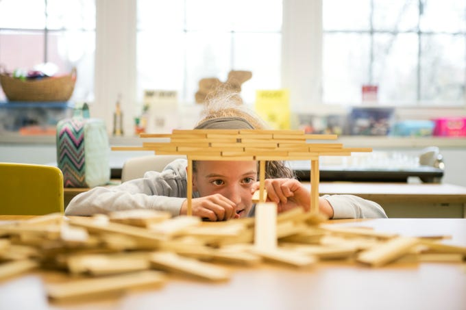 Jaclyn Dunn, 12, builds a balancing structure at Pitman Middle School's MakerSpace Thursday, Jan. 10, 2019 in Pitman, N.J.