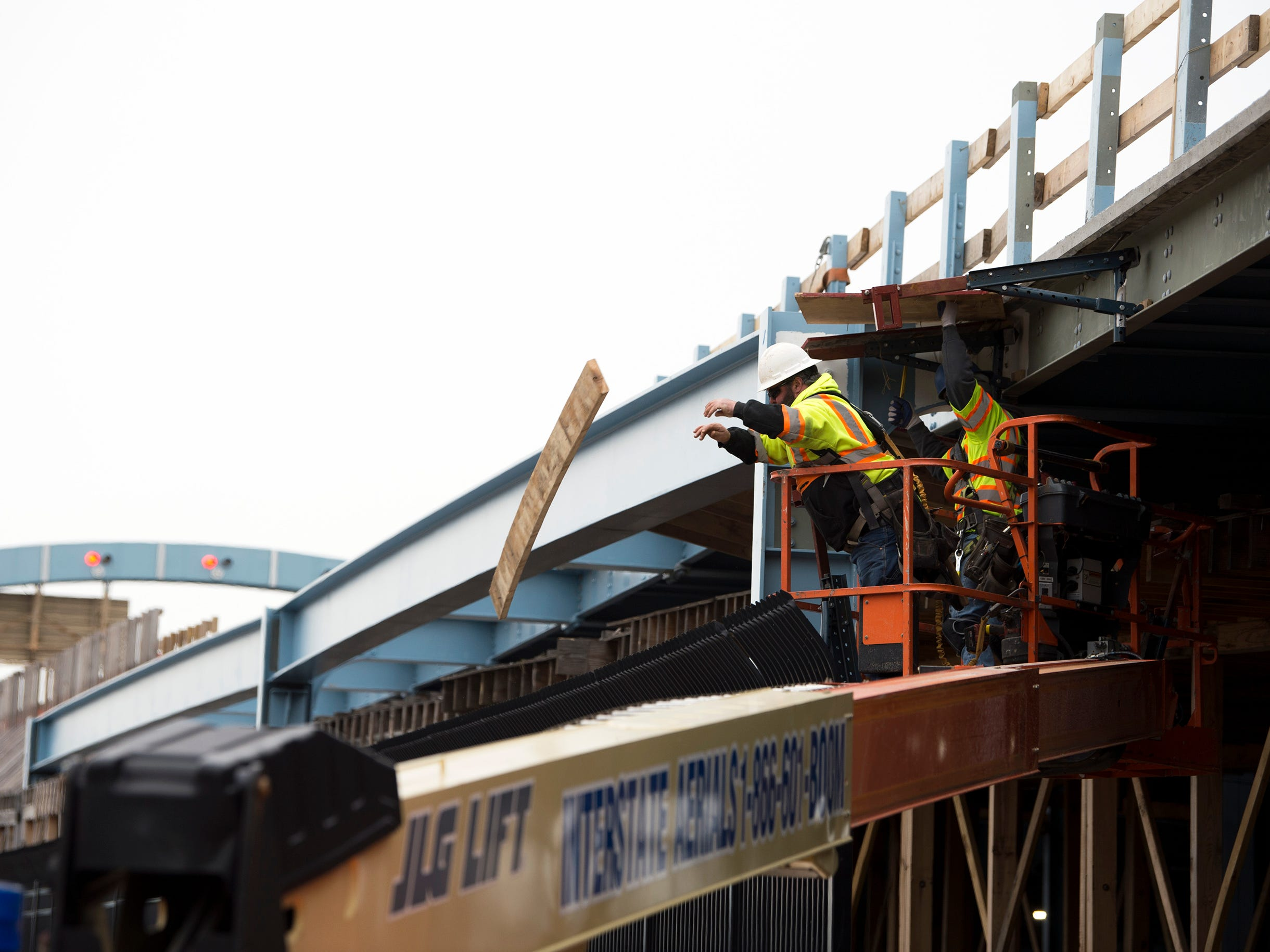 Carpenters Local 255 worker Mike Carman of Collingswood  removes temporary wooden ramp supports during ongoing construction continues of a pedestrian and bicycle ramp on the Benjamin Franklin Bridge Monday, Jan. 7, 2019 in Camden, N.J.