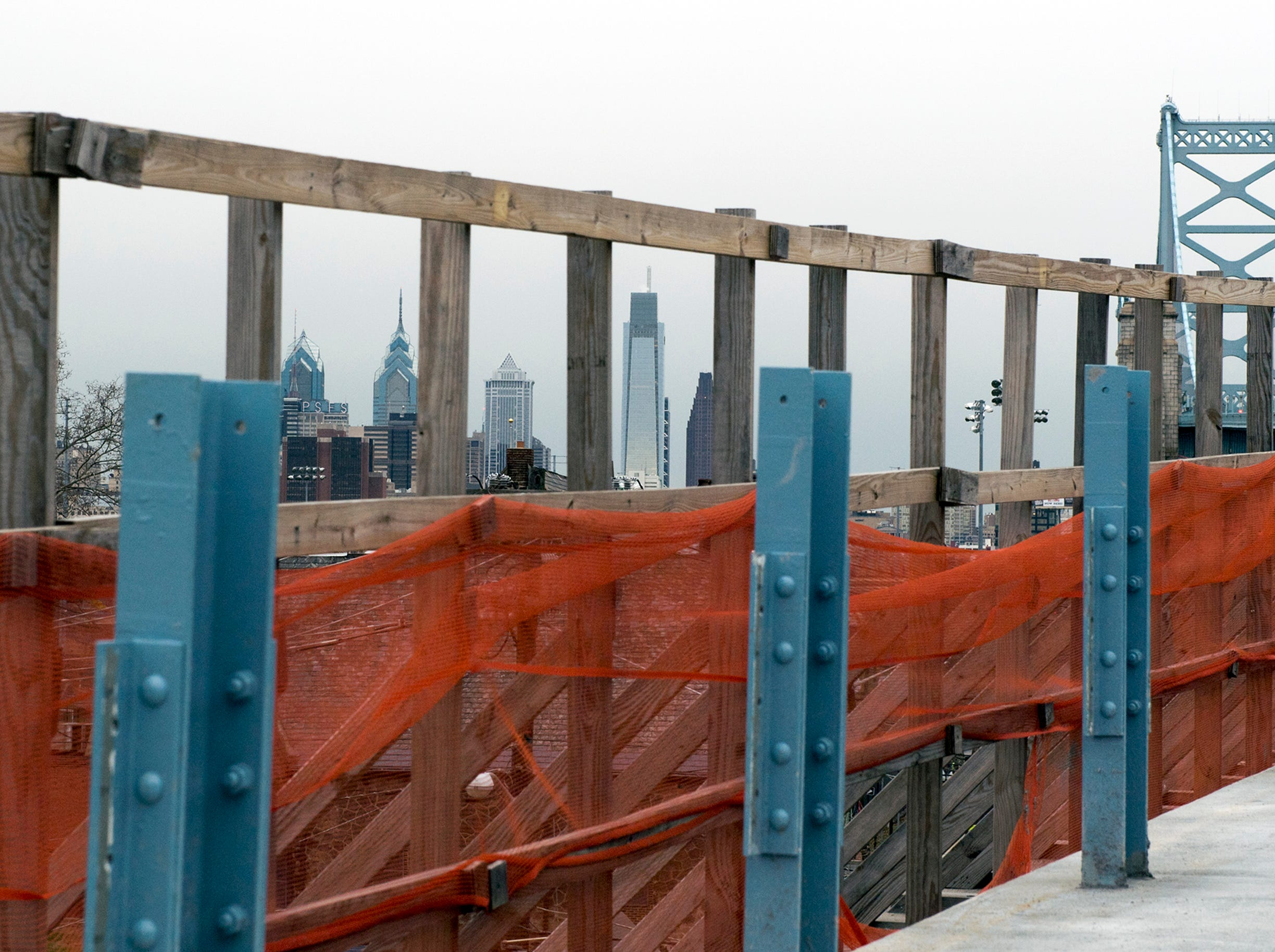 A view of the Philadelphia skyline as construction continues on a pedestrian and bicycle ramp( in foreground on the Benjamin Franklin Bridge Monday, Jan. 7, 2019 in Camden, N.J.