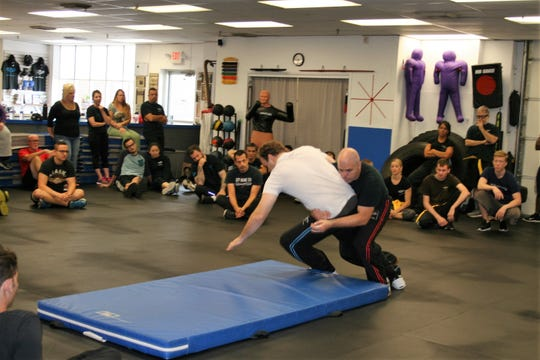 Rinaldo Rossi demonstrates a takedown at an active-shooter training session at Israeli Krav Maga Cherry Hill. The workshops operate on the Department of Homeland Security directive to 'Run. Hide. Fight.""