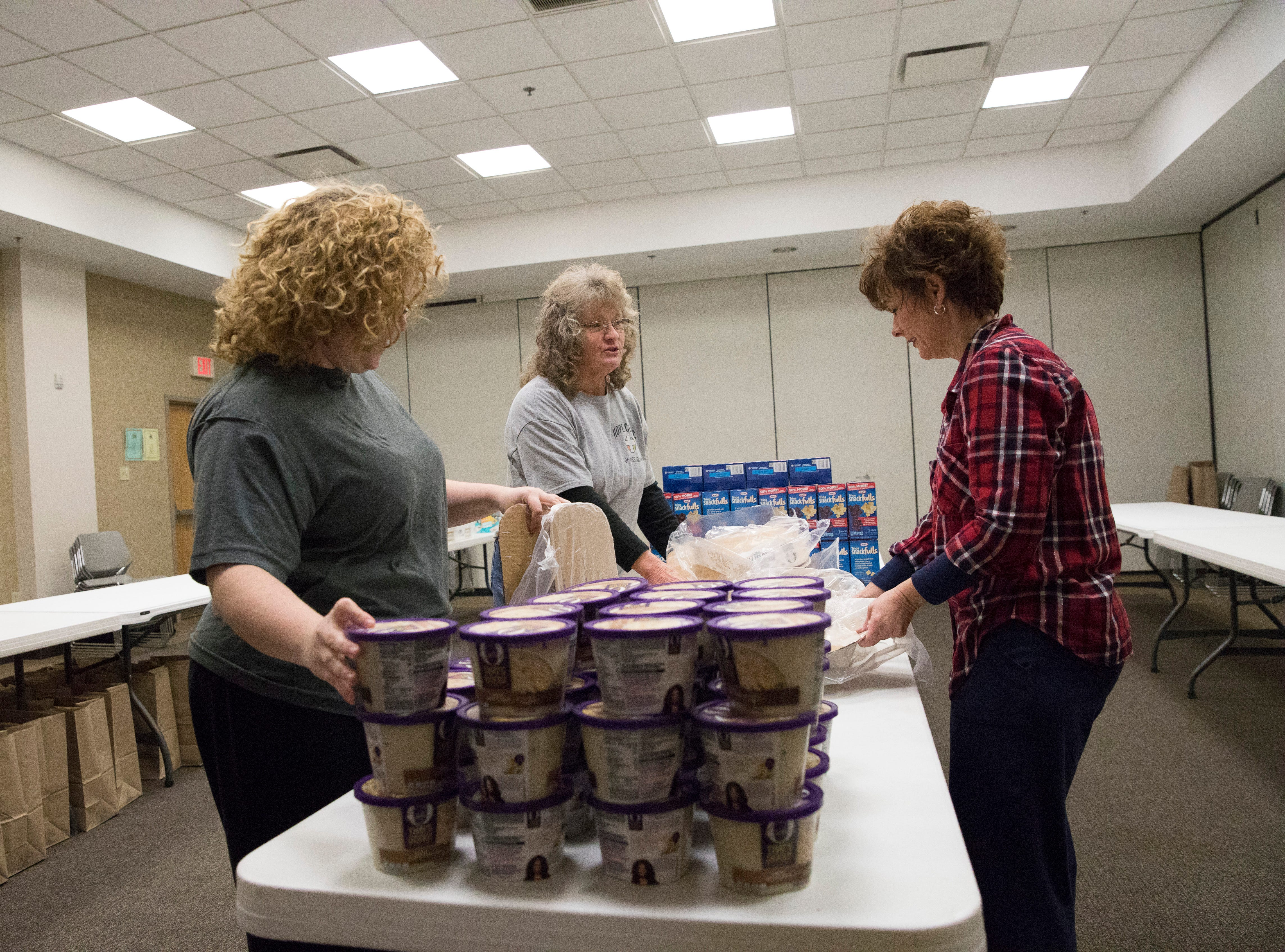 Volunteers for the Mobile  Market give up their time every second and fourth Monday of the month to help supply food to residents who are in need.