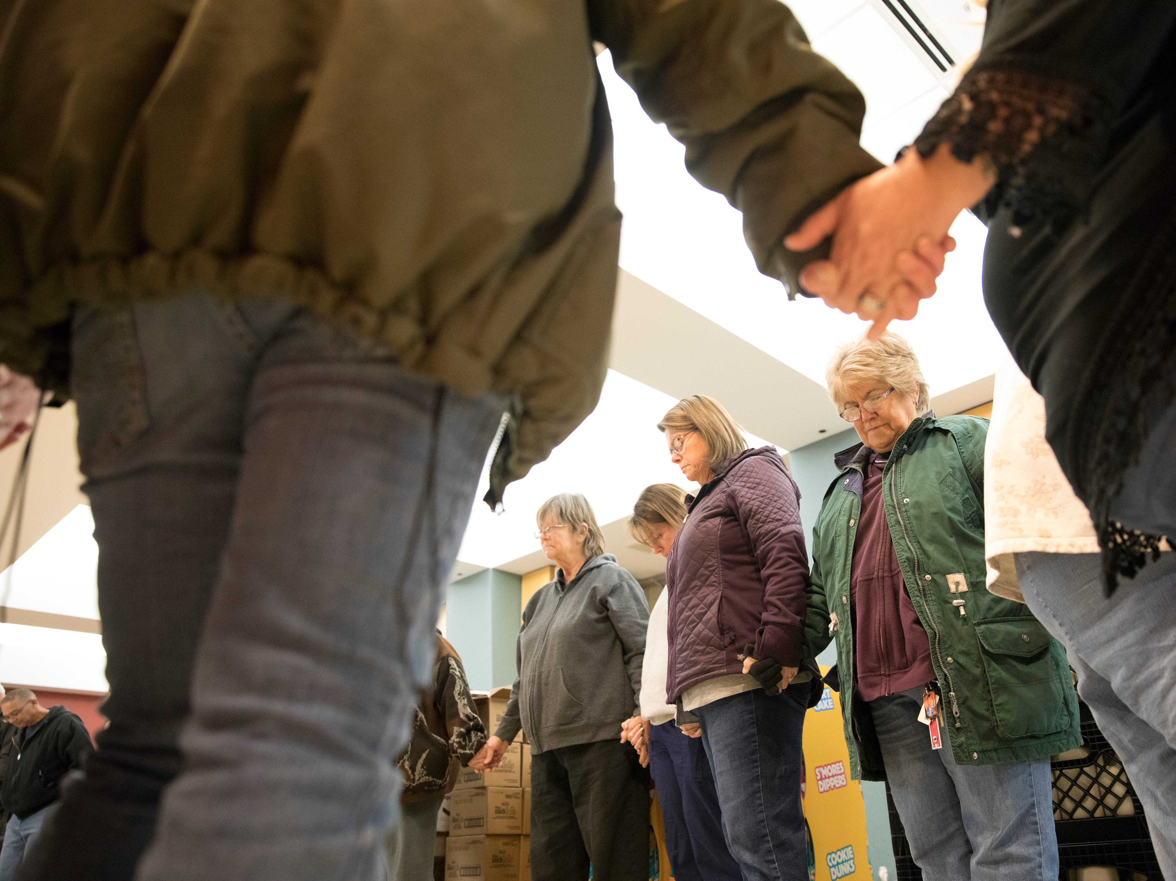 Volunteers pray to thank God for their ability to help those that may not be able to get the groceries otherwise during the first Mobile Market  in Chillicothe, Ohio.