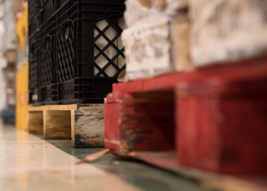 Pallets are placed directly on the floor which causes scratches and other marks. The weight of the skids may be warping the floor.