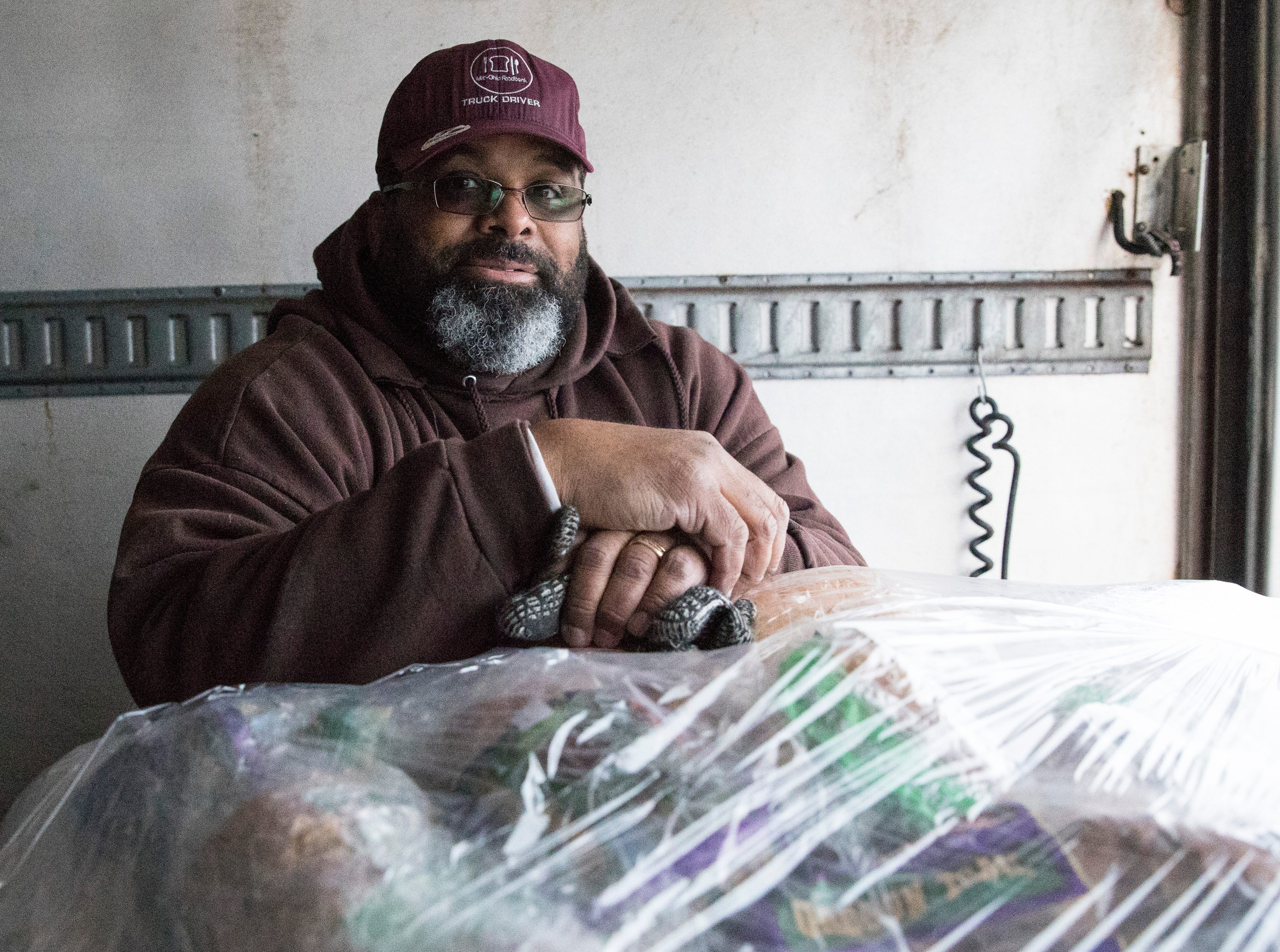 Von Davis from the Mid-Ohio Food Bank waits as items are unloaded from his truck to the Mobile Market  located at the Ross County Service Center on Jan. 14, 2019.