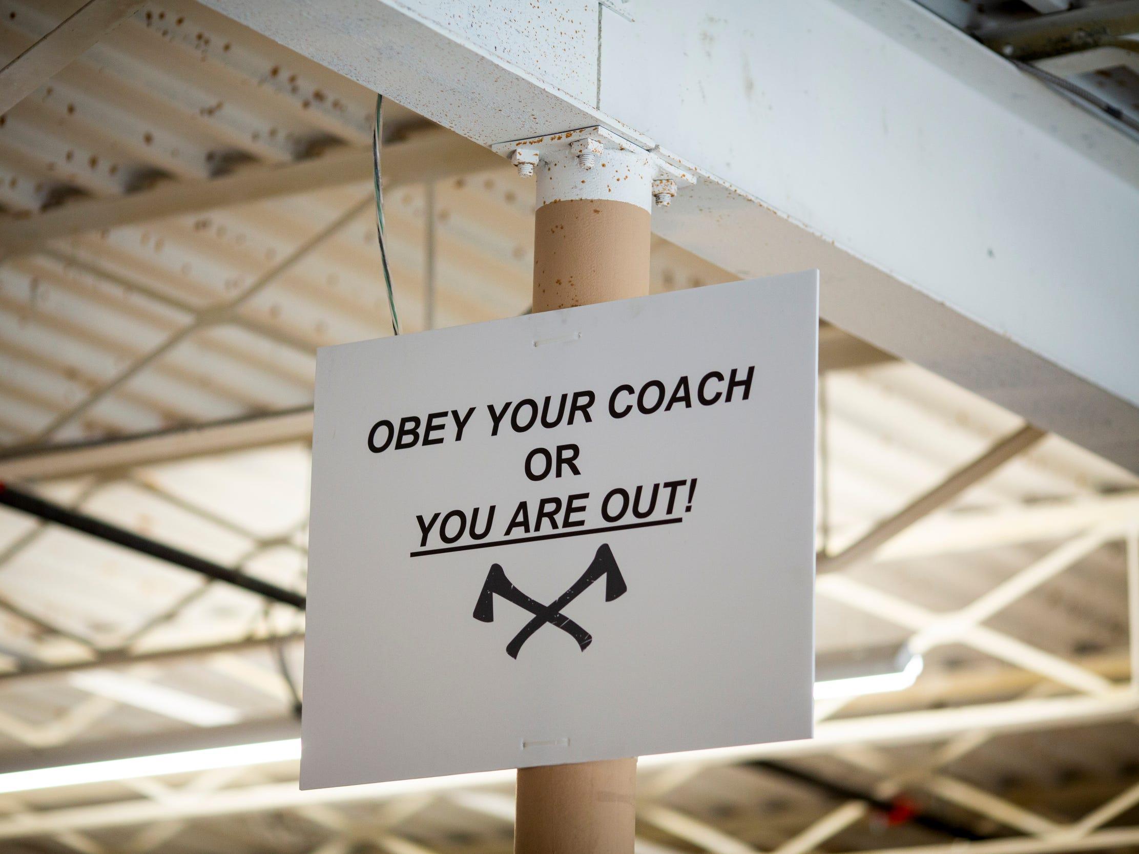 Coaches at Urban Axes Cincinnati teach patrons how to throw axes safely in each arena.