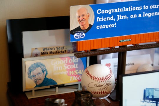 Memorabilia from a career spanning 55 years in radio stands on a desk at Jim Scott's home in Lawrenceburg, Ind.