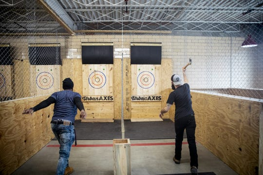 "Urban Axes Cincinnati coaches Jackie ""Jinx"" Jackson and Ryan Bell demonstrate axe throwing at Urban Axes Cincinnati Tuesday, January 15, 2019 at a media preview."