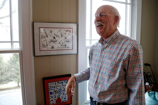 Retired broadcaster Jim Scott laughs as he recalls a cartoon drawn by Enquirer cartoonist Jim Borgman featuring him at his home in Lawrenceburg, Ind., on Thursday, Jan. 10, 2019. Scott retired from radio in 2015 after more than 50 years in the broadcasting business.