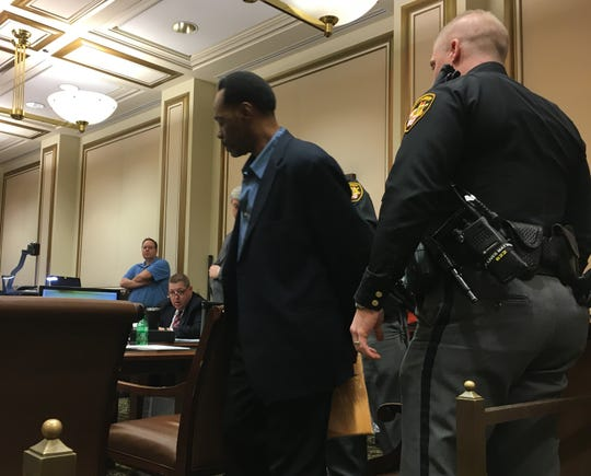 Thomas Walker is led into Hamilton County Common Pleas Judge Tom Heekin's courtroom Tuesday, Jan. 15, 2019, as his murder trial continued.