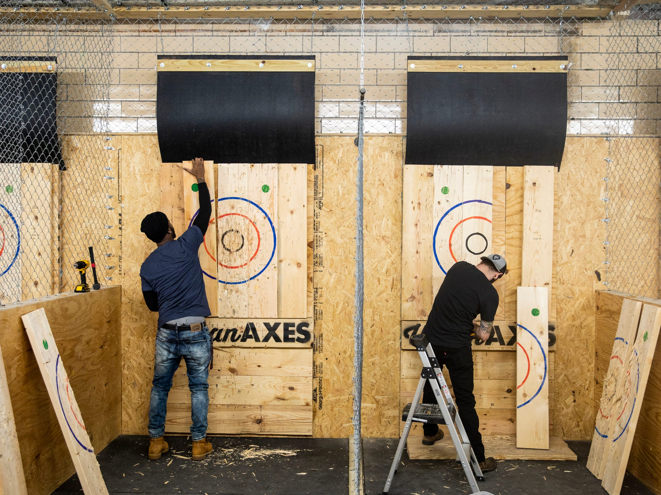 """Urban Axes Cincinnati coaches Jackie """"Jinx"""" Jackson and Ryan Bell replace the National Axe Throwing Federation targets."""