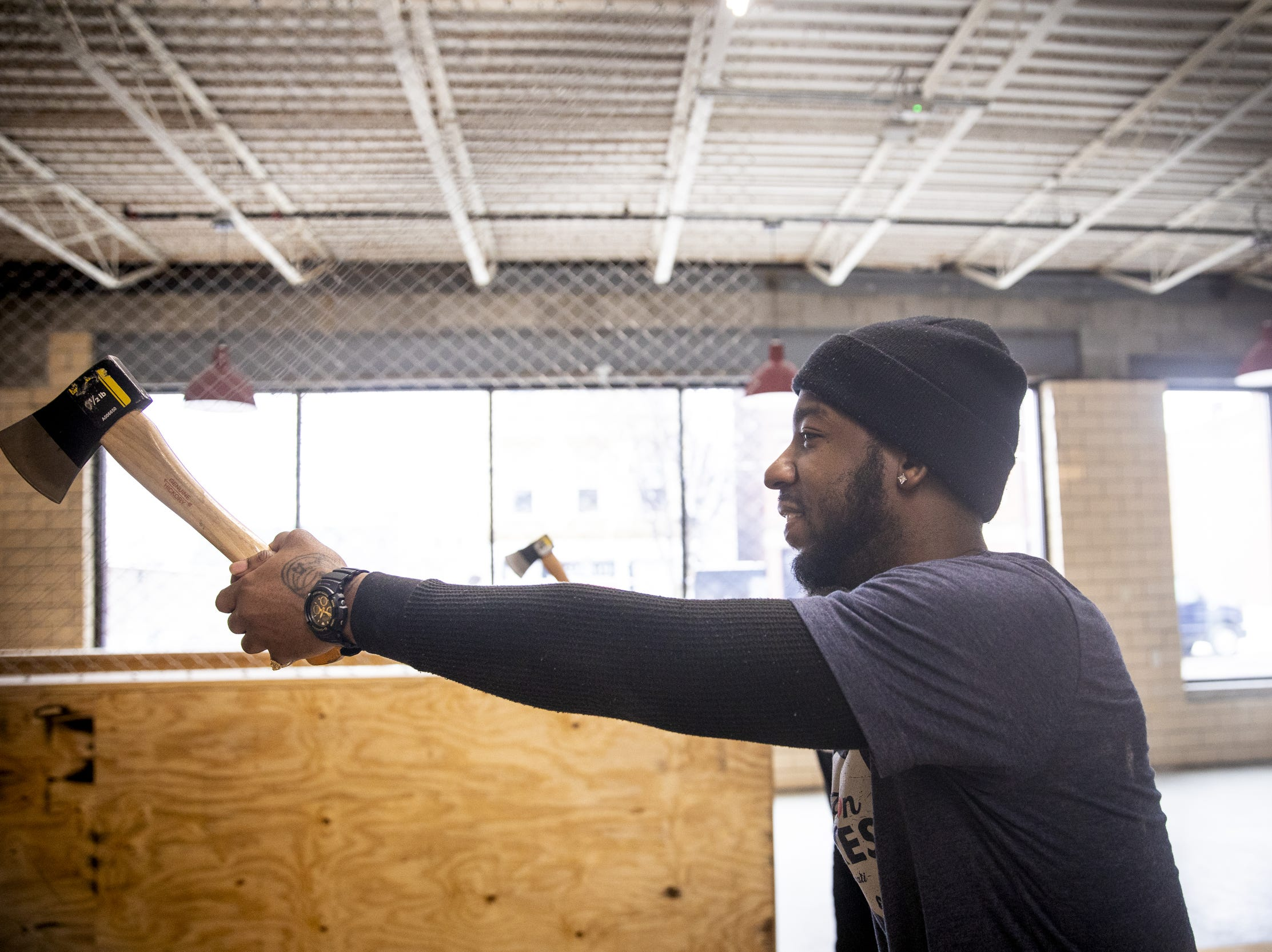 "Jackie ""Jinx"" Jackson, a coach at Urban Axes Cincinnati, demonstrates axe throwing at Urban Axes Cincinnati Tuesday, January 15, 2019 at a media preview."