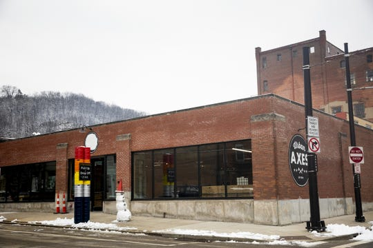 Urban Axes Cincinnati will open next to Rhinegeist Brewery on Elm Street in Over-the-Rhine Friday, January 25, 2019.  Urban Axes Cincinnati's bar will offer beer and wine. Patrons can bring their own food to the space.