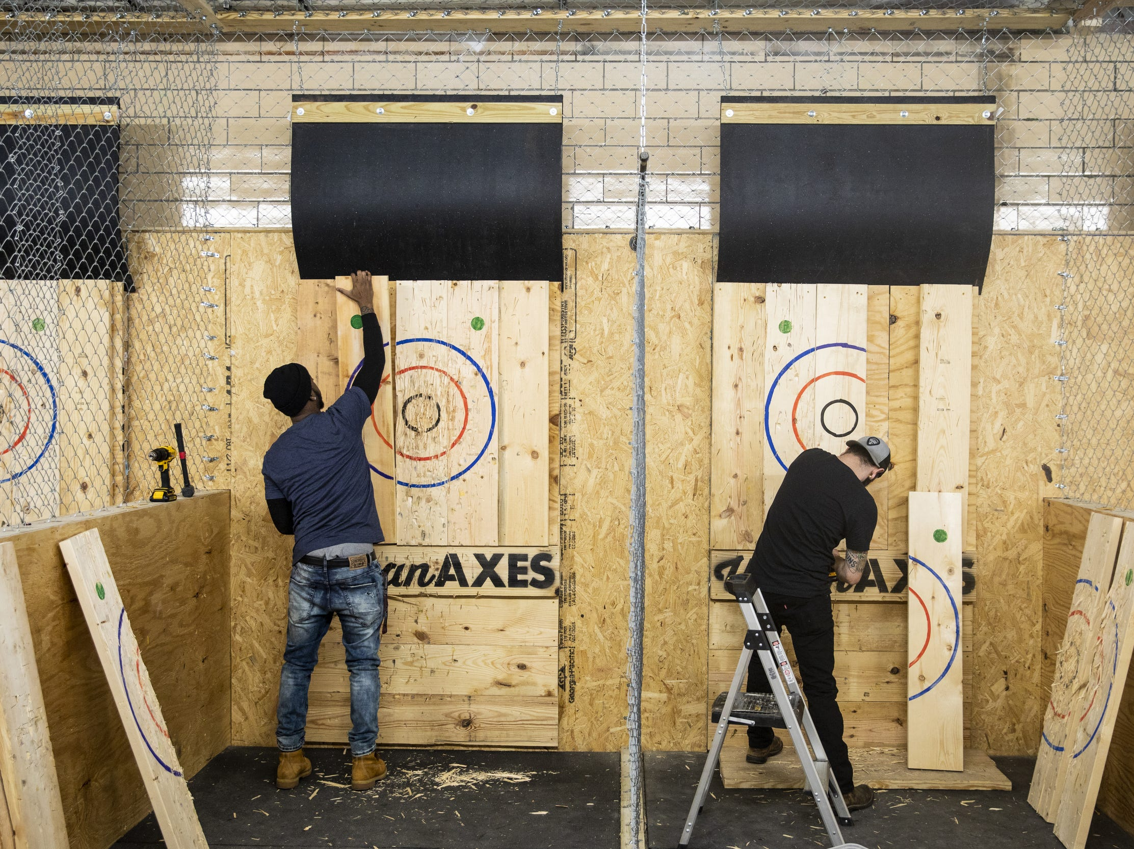 "Urban Axes Cincinnati coaches Jackie ""Jinx"" Jackson and Ryan Bell replace the National Axe Throwing Federation targets."