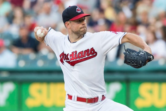 Cleveland Indians starting pitcher Corey Kluber (28) throws a pitch during the first inning against the Tampa Bay Rays at Progressive Field.