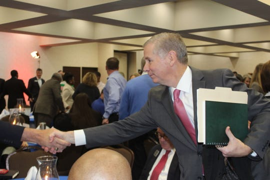 """Clarksville Mayor Joe Pitts greets attendees at the """"Mayor's Power Breakfast"""" on Tuesday morning at the Riverview Inn."""