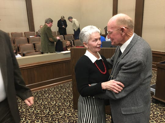 Rosalind Kurita is congratulated Monday  night by County Commissioner Joe Creek upon being elected interim state senator until this spring's special election to replace U.S. Rep Mark Green in the Tennessee General Assembly.
