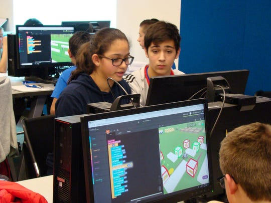 Maya Dias (left) and Aaron Richman were among four Edison 8th graders who advanced to the finals in CoderZ online challenges and were invited to participate in two-person teams in the 2018 New Jersey Cyber Robotics Coding Competition Finals on Dec. 14 at NJIT.