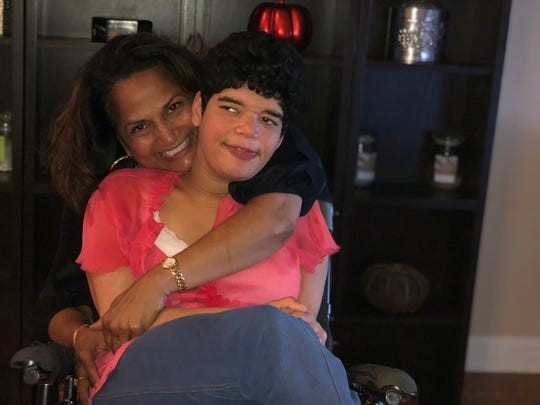Lorraine D'Sylva-Lee, mother of Aaliya, is one of 1.75 million New Jerseyans who are caregivers — a growing group who often sacrifice much in their own lives for their loved ones.