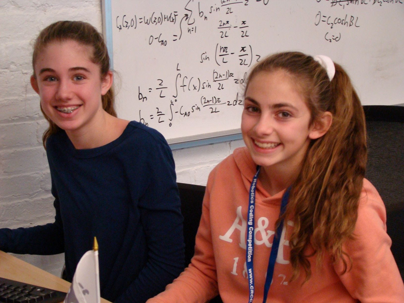 Edison 8 grader Catherine Collins (left) and Gabriela Gil placed 3rd in the 2018 New Jersey Cyber Robotics Coding Competition Finals on Dec. 14 at NJIT.