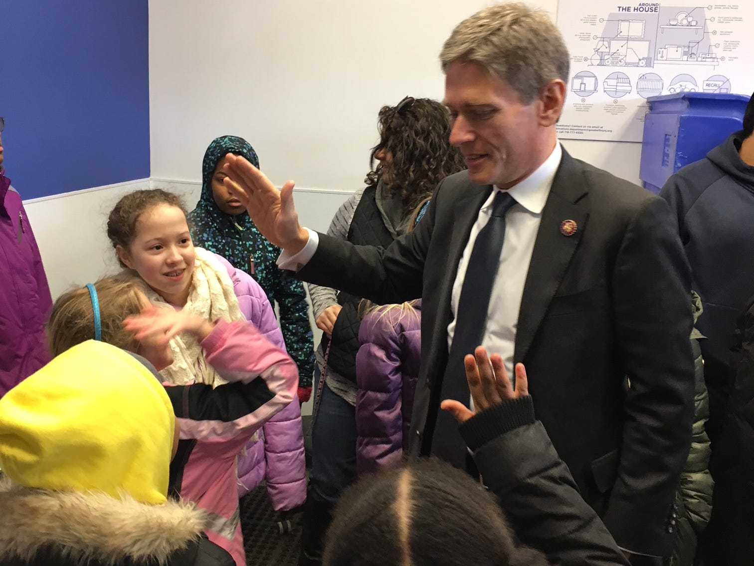 Twenty-five girls from the North Plainfield Girl Scout Troop number 65141 stopped by the Goodwill store at 955 Route 22 West in North Plainfield, to drop bags of donations on Saturday, Jan. 12. Newly-elected U.S. Congressman Tom Malinowski (NJ District 7) helped present the GoodTurn patches, which were designed by the marketing department of Goodwill NYNJ, to the girl scouts for their donations.