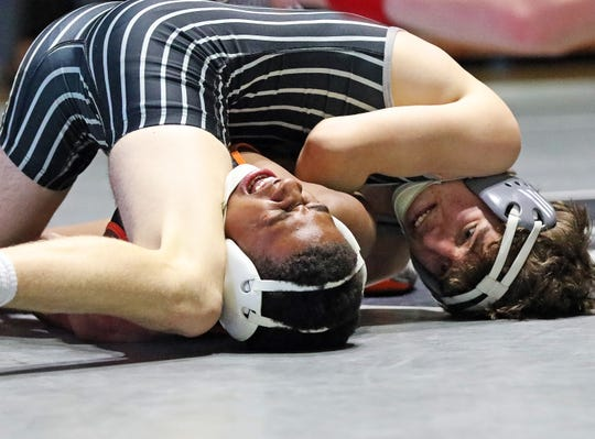 Ankeny Centennial senior Noah Blubaugh pins Ames freshman Anthony Davis during their 126-pound match at a Jan. 10 dual meet. Blubaugh had a key win to help the Jags to a third-place finish at the state dual meet.