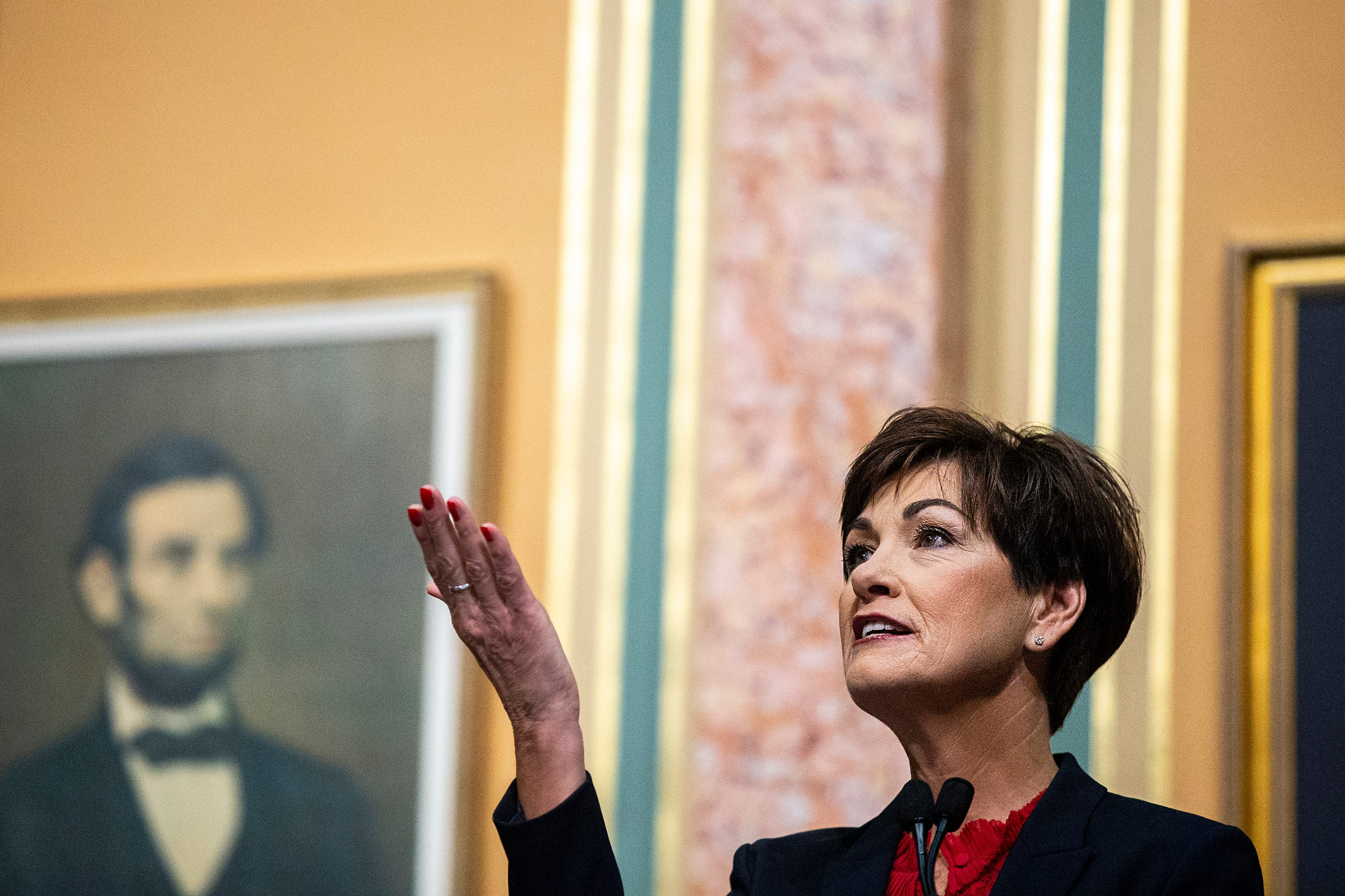 Kim Reynolds' proposal would restore voting rights to felons who have served their sentences