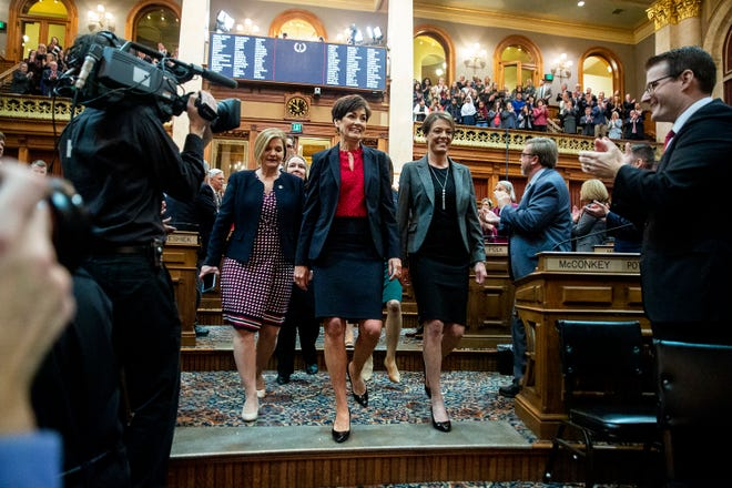 Governor Kim Reynolds is escorted into the House chamber by a committee of Representatives and Senators before giving her Condition of the State address on Tuesday, Jan. 15, 2019, at the Iowa State Capitol in Des Moines.
