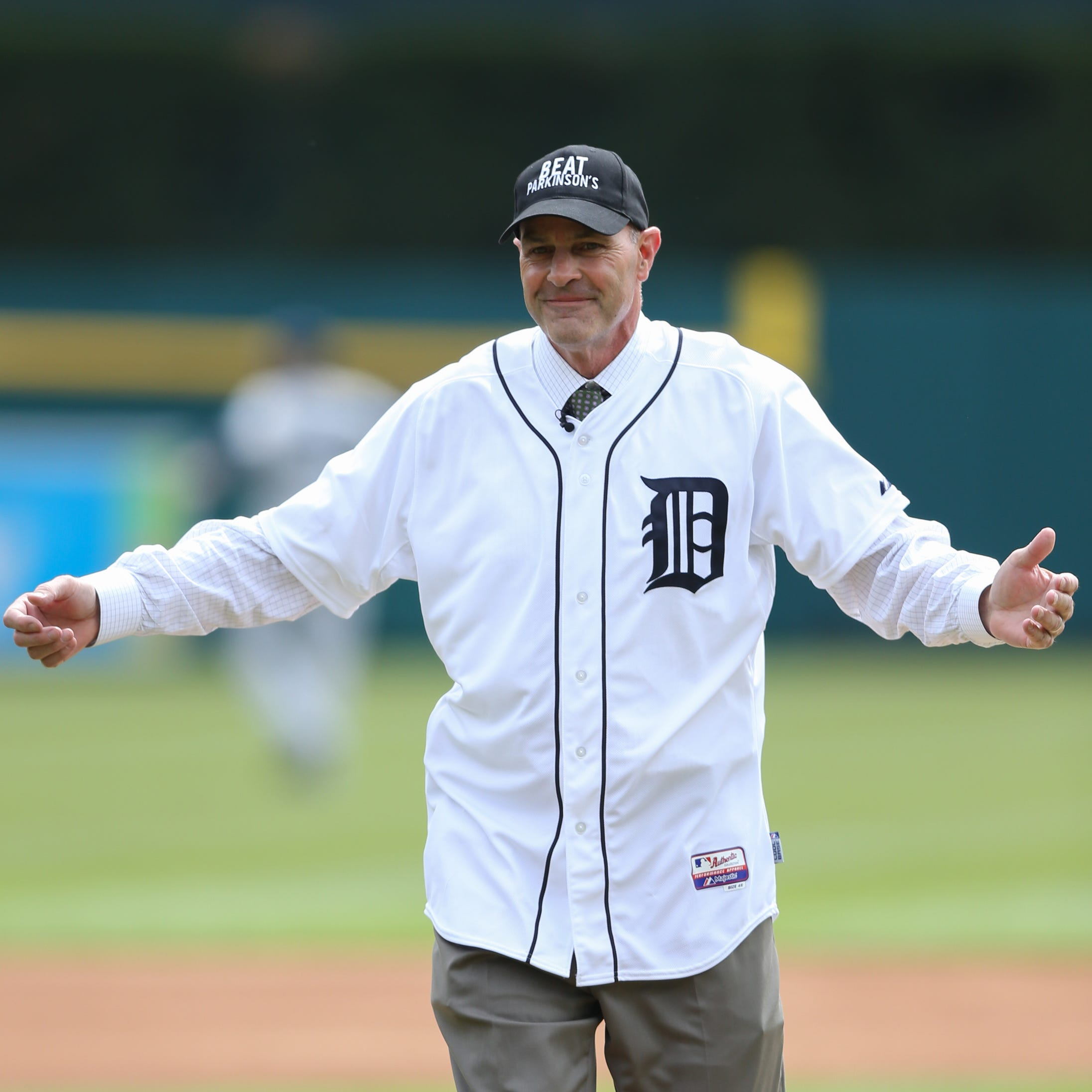 Kirk Gibson throws out the first pitch before...
