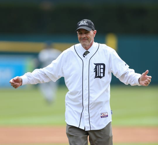 Kirk Gibson throws out the first pitch before action against the Yankees on April 8, 2016 at Comerica Park in Detroit.